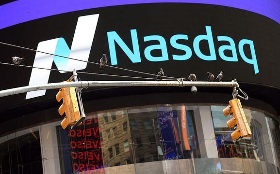 Nasdaq hits 6,000 mark, a record as tech stocks climb
