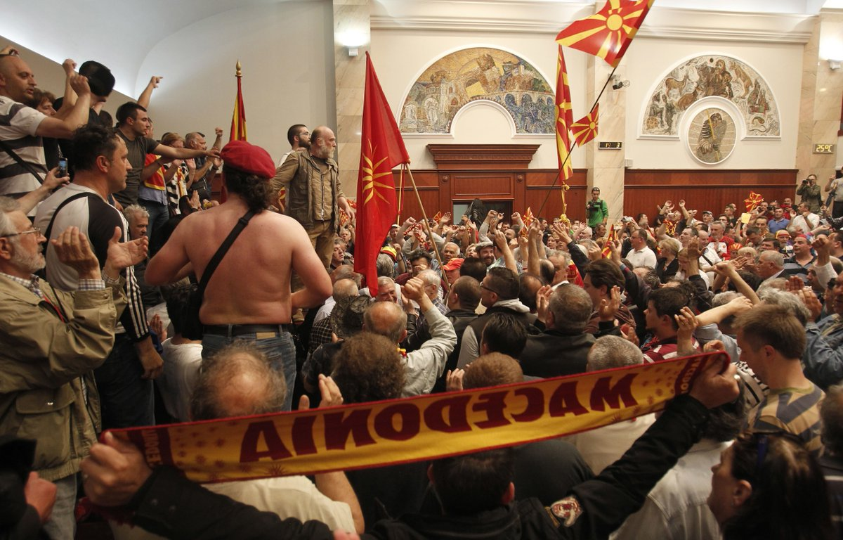 Lawmakers attacked as protesters storm Macedonian parliament