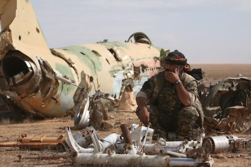 U.S.-backed forces push against IS in slowed Raqqa campaign