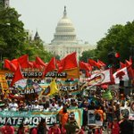 Thousands brave weather to protest climate policies on Trump's 100th day
