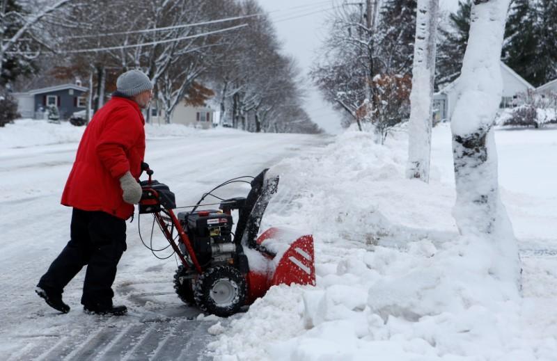Winter storm socks U.S. New England region, snaps power lines