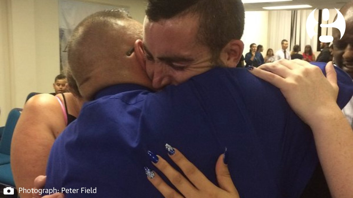 Father hugs man accused of Christmas Day crash that killed his son