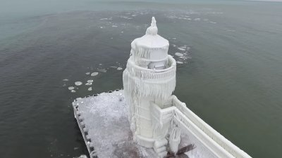Frozen Michigan lighthouse looks out of this world in drone video