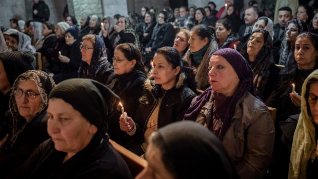 Displaced Iraqi Christians head home for 'wartime' Christmas