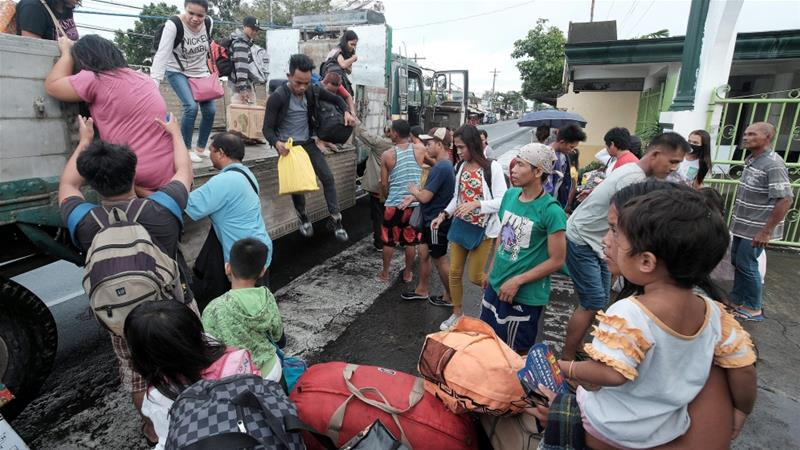 Thousands flee typhoon Nock-Ten in the Philippines on Christmas Day