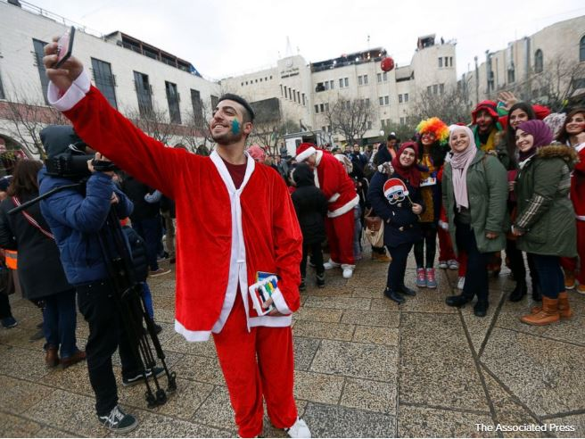 Thousands of faithful celebrate Christmas in biblical town of Bethlehem.