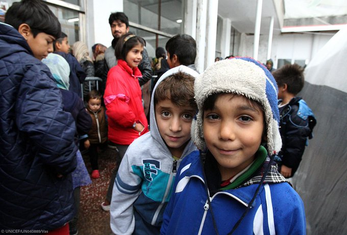 At a transit centre near the Serbia-Croatia border, smiling #refugee &  chi#migrantldren receive warm winter clothes from us. @UNICEFceecis