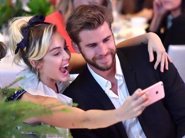 Shocker: Miley Cyrus And Liam Hemsworth Continue To Be The Cutest Couple On The Plane...