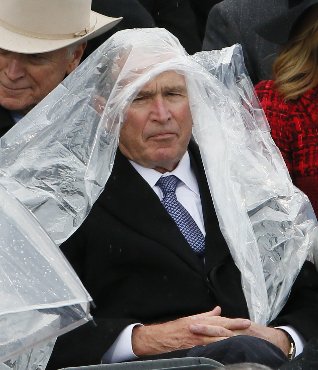 Looks like Ol Dub came for the inaugural speech but prepared for golden showers. ☔ hah!  I do so amuse
