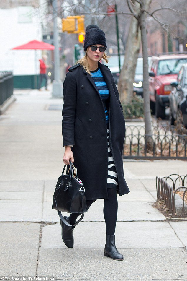 Supermodel Karlie Kloss nails off-duty chic in blue midi dress and fur hat https://t.co/T4XtgJykVZ