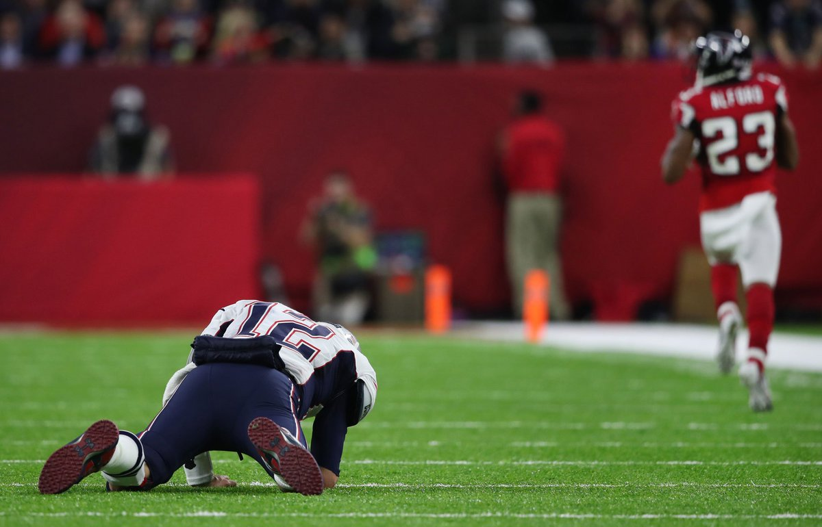 Tom brady on the ground after his interception to cornerback
