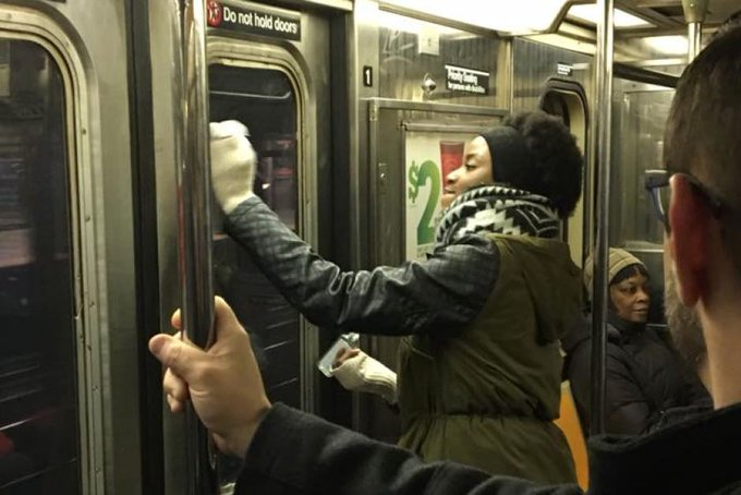 Commuters band together to remove swastika #graffiti from #NY subway (Pic: Gregory Locke)  https://t.co/diwBcRvVPG