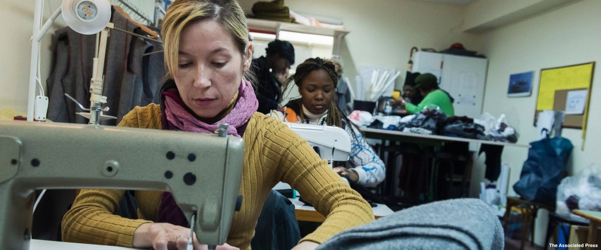 Volunteers in Greek city turn old blankets into winter coats for refugees.