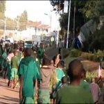Parents march against, then declare support for teacher