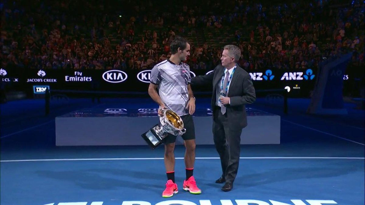 rogerfederer does a lap of honour with the norman brookes