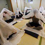 New mums easing pregnancy pain using bizarre Tokyo trend of Otonamaki – where they wrap themselves up in white bags
