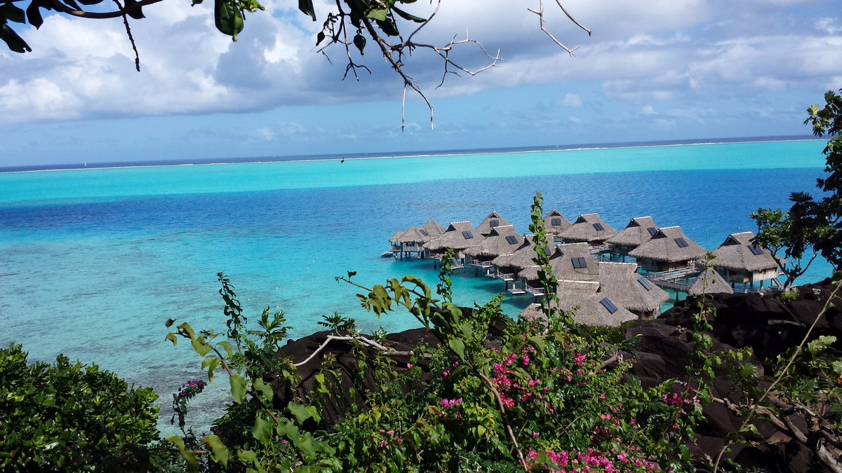 #BoraBora is the place to be - night or day.  #TravelTuesday https://t.co/fWjENfG7OS