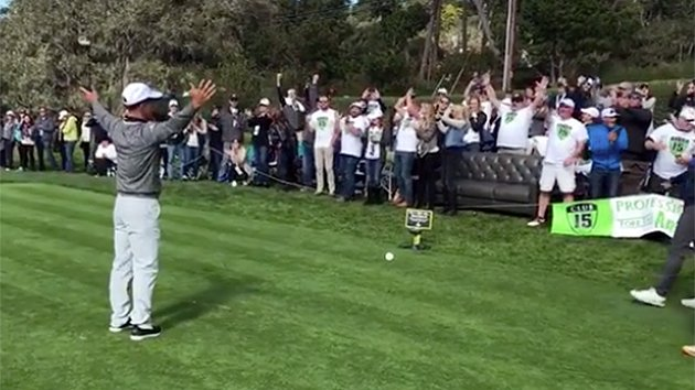 WATCH the crowd belt out to as he tees off