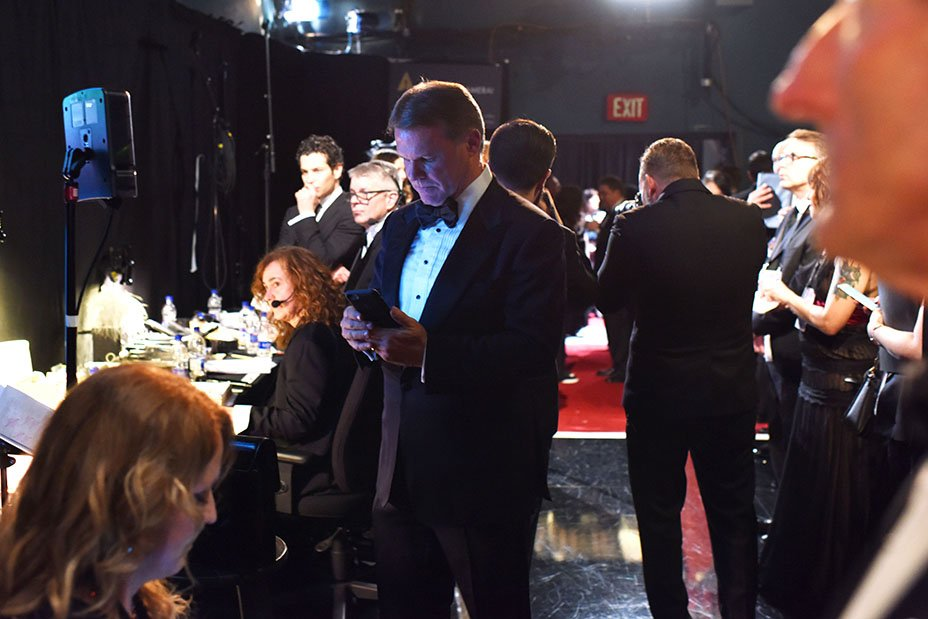 Oscars: Photos show accountant tweeting backstage before Best Picture flub