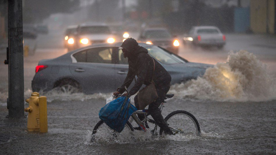Crazy storm has streets of L.A. swallowing cars whole