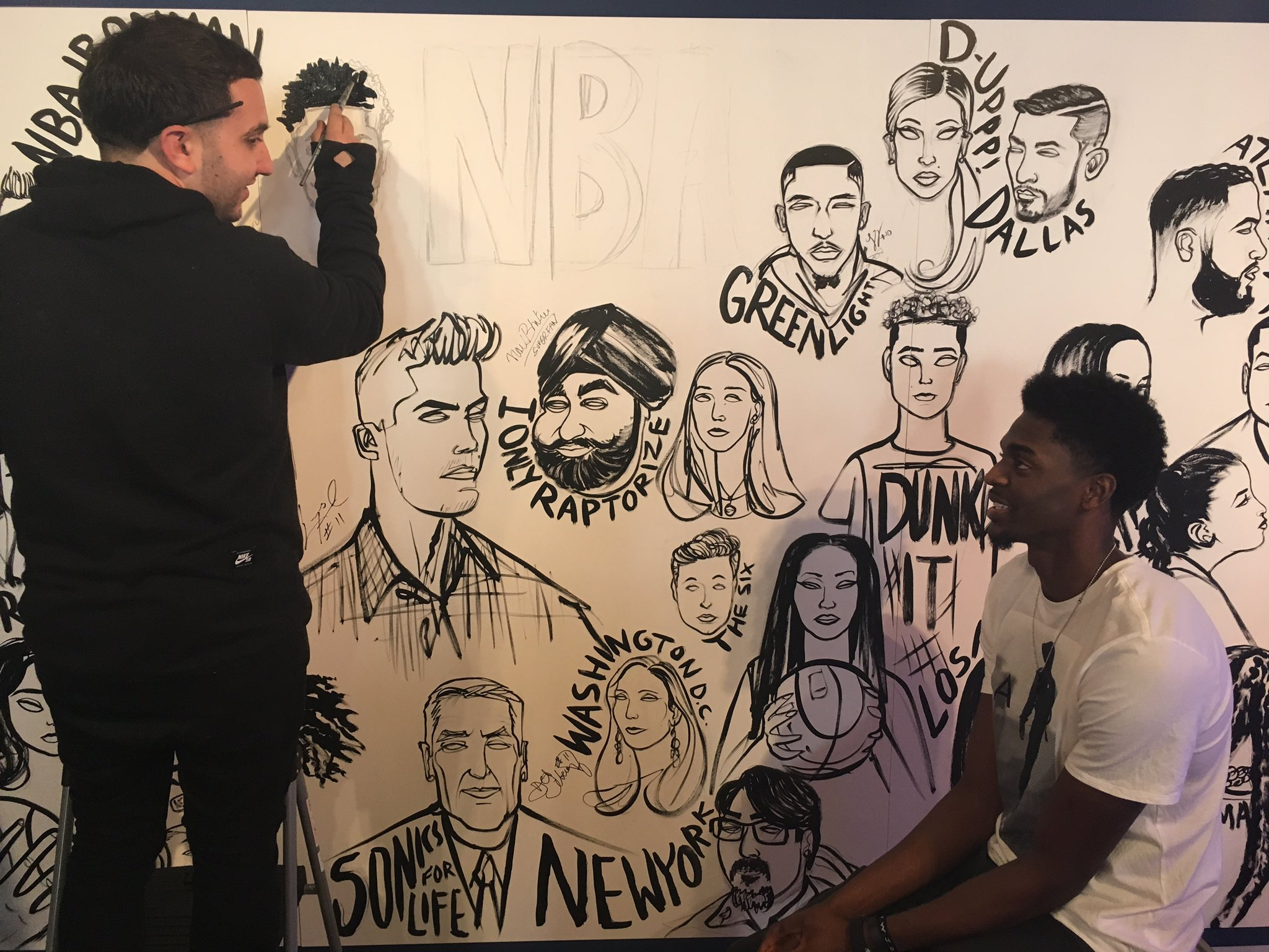 .@JustHolla7 is at #NBACrossover becoming a part of the sketch wall! Come check it out until 6pm today! https://t.co/Pt3NK7ujf1