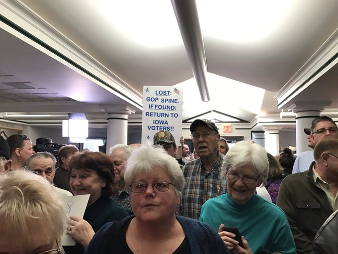 It's Ernst's only town hall this recess, and Deb (front and center) says it's bulls*** it was in a small room in rural Iowa. The spillover: