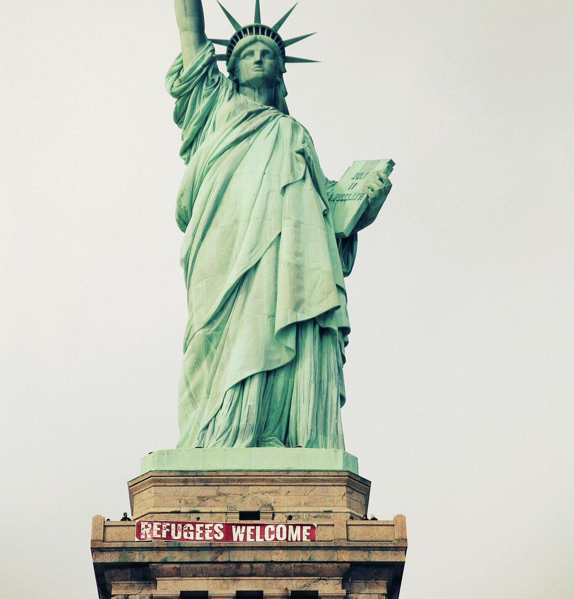 'Refugees Welcome' banner unfurled on pedestal of Statue of Liberty; United States Park Police working to identify suspects.