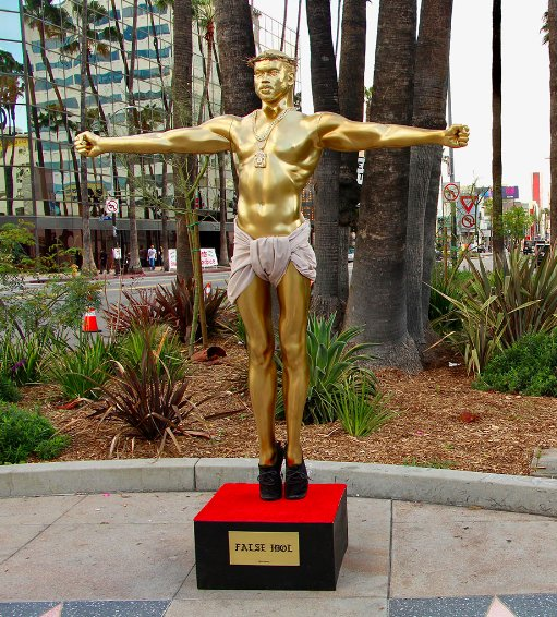 Kanye West crucifix statue appears in Hollywood a block from the Oscars Dolby Theatre