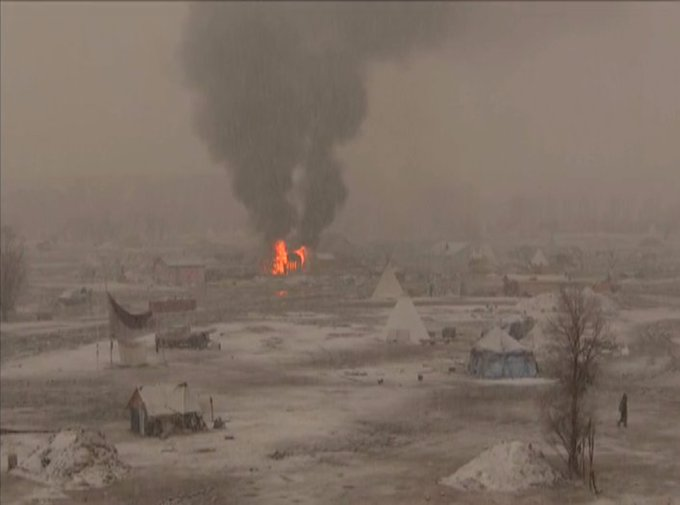MORE: Dakota Access pipeline protesters torch tents ahead of this afternoon's eviction deadline. https://t.co/7thT8zkhuT