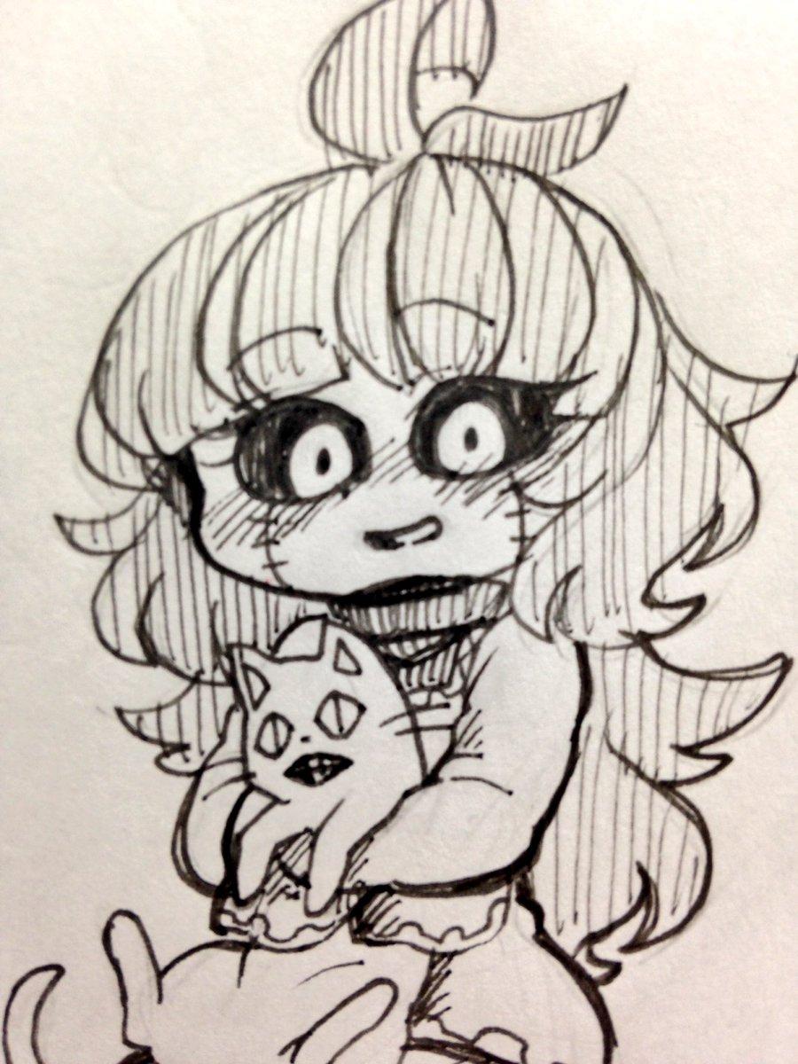 ネコを抱えて思わず顔を綻ばせるフランチェスカ