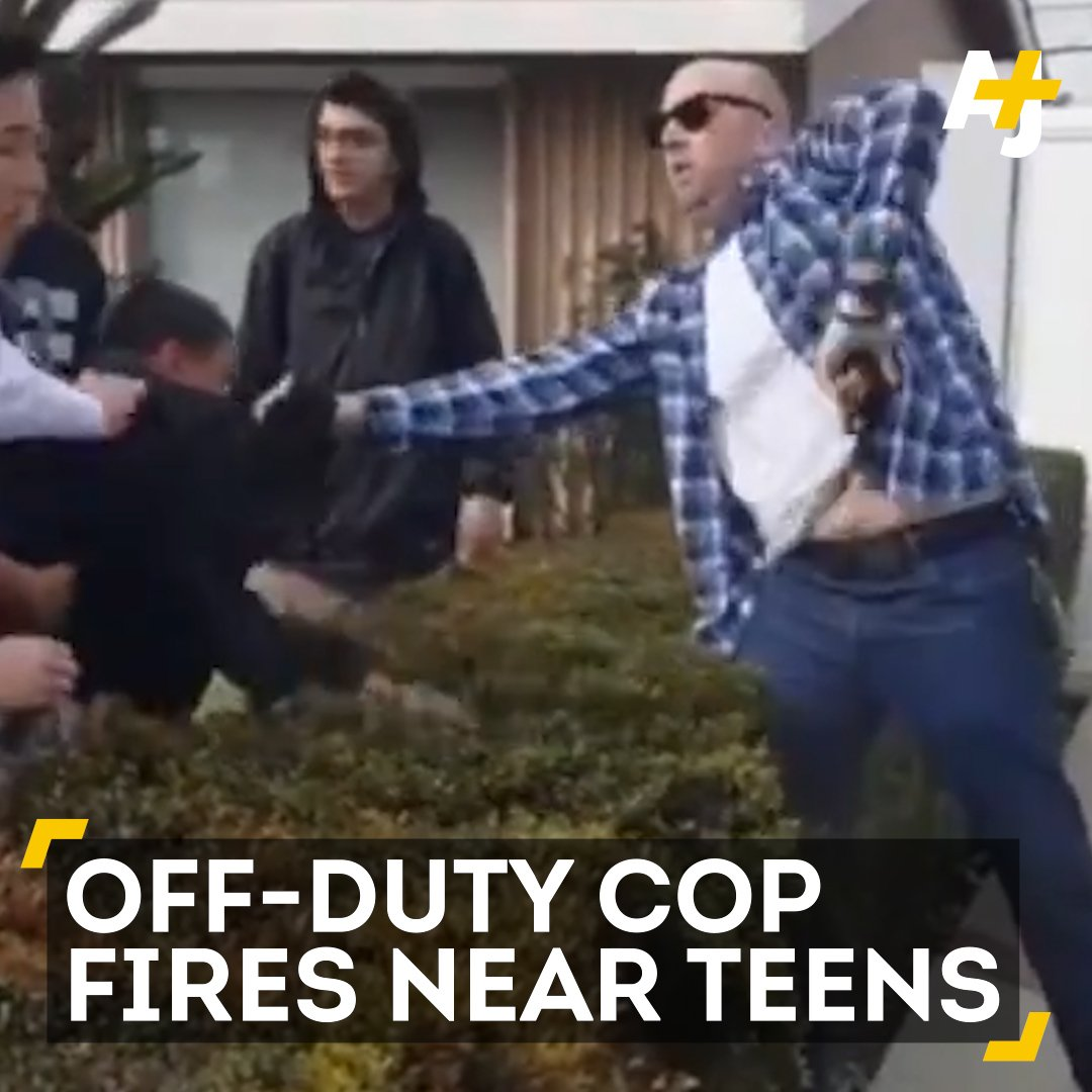 An off-duty officer was holding onto a 13-year-old when he fired his gun.