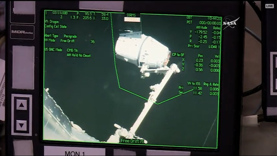 Capture confirmed! Dragon now attached to the @Space_Station robotic arm