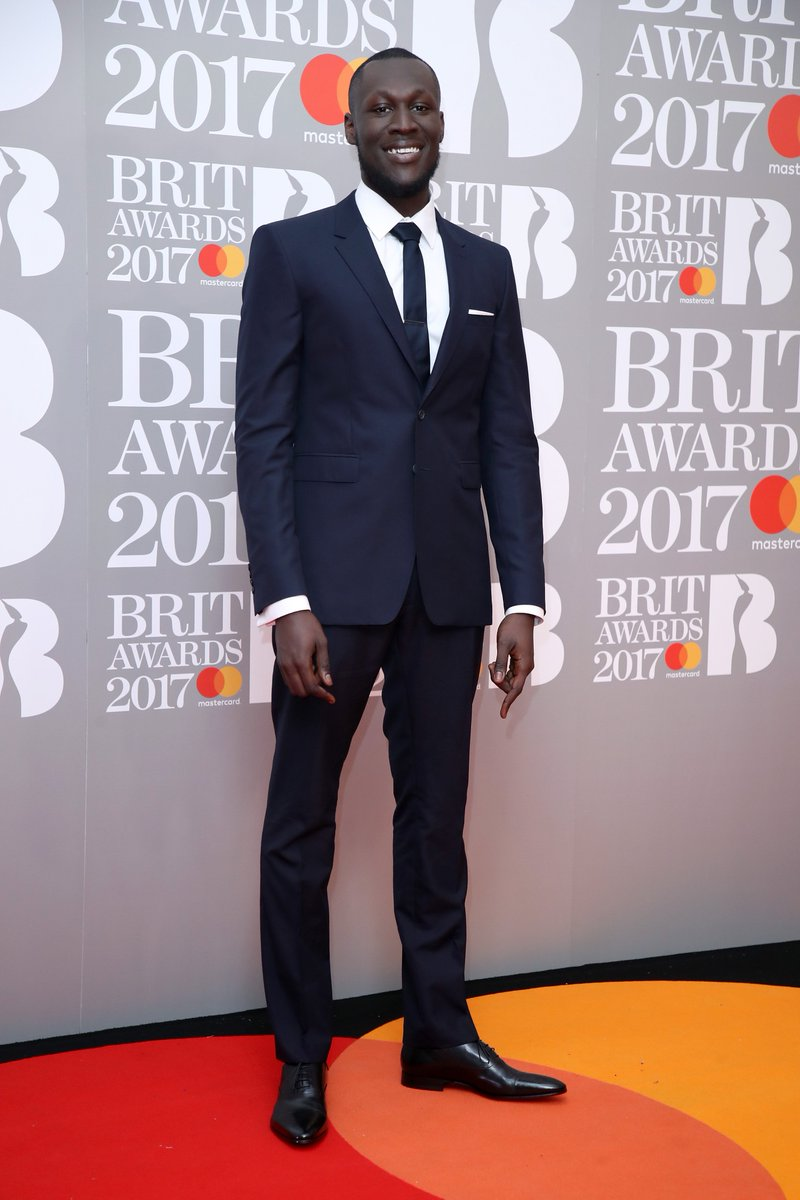 #BRITs nominee for British Breakthrough Act @Stormzy1 wears @Burberry tailoring on the red carpet last night https://t.co/XaQDZK3Zvh