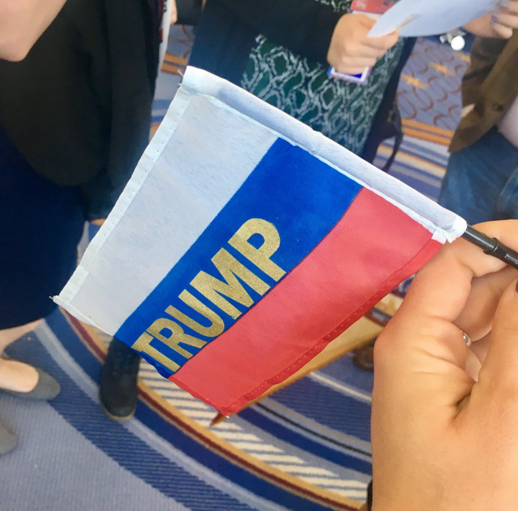 trump supporters waved flags that look like the russian flag with
