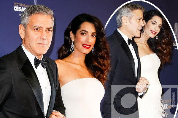 Amal and George Clooney CONFIRM baby joy as they walk the red carpet hand in hand