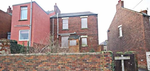 This two-bedroom terrace is on the market for just £1… but it needs A LOT of work