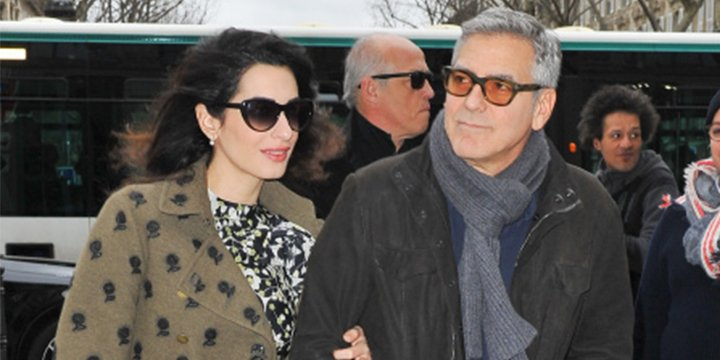 Pregnant Amal and George Clooney leave Paris arm-in-arm after romantic weekend