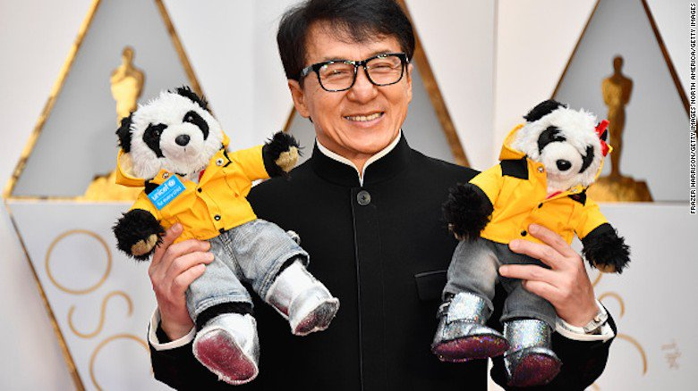 Jackie Chan boldly brought two dates to the Oscars this year: two stuffed pandas ??