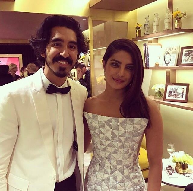 Chilling in Hollywood!@priyankachopra and #DevPatel catch up at the #Oscars
