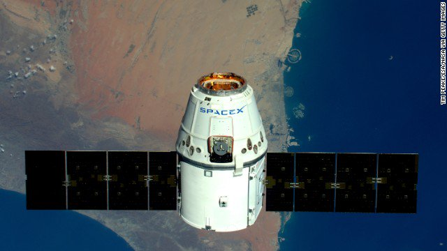 SpaceX CEO Elon Musk announces company will fly two tourists around the moon next year.