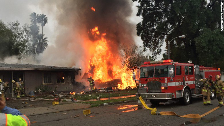 A small plane crashed into two homes Monday in Riverside, California, authorities say