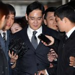 Samsung Group chief charged with bribery, corporate nerve centre dismantled
