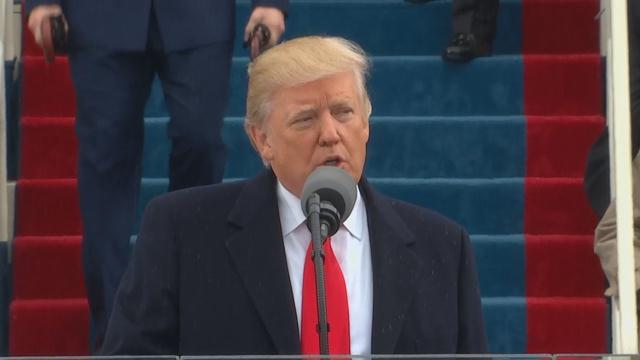 President Donald Trump signs new travel ban, exempts Iraq
