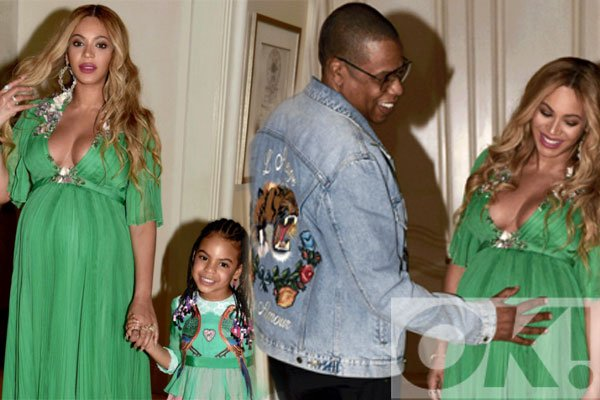 Pregnant @Beyonce is all smiles as hubby Jay Z places a hand on her blossoming baby bump