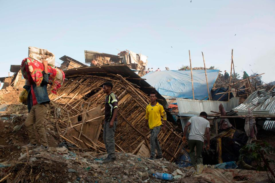 At least 46 dead including children after huge rubbish dump collapses and buries homes in Ethiopia