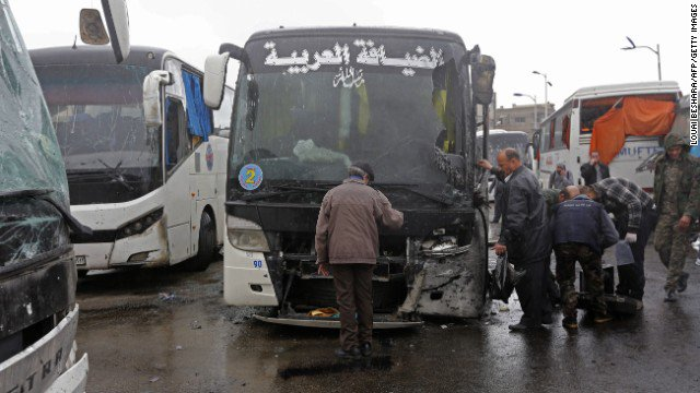 Death toll from Saturday's twin blasts in Damascus climbs to 74, human rights group says.
