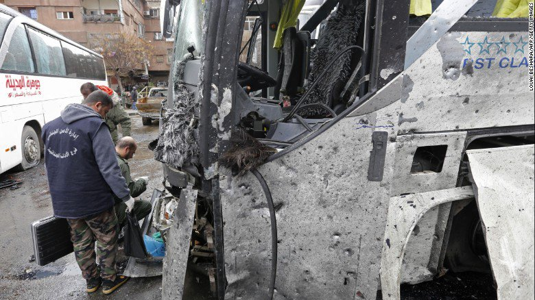 The death toll from twin blasts Saturday in Damascus has climbed to 74