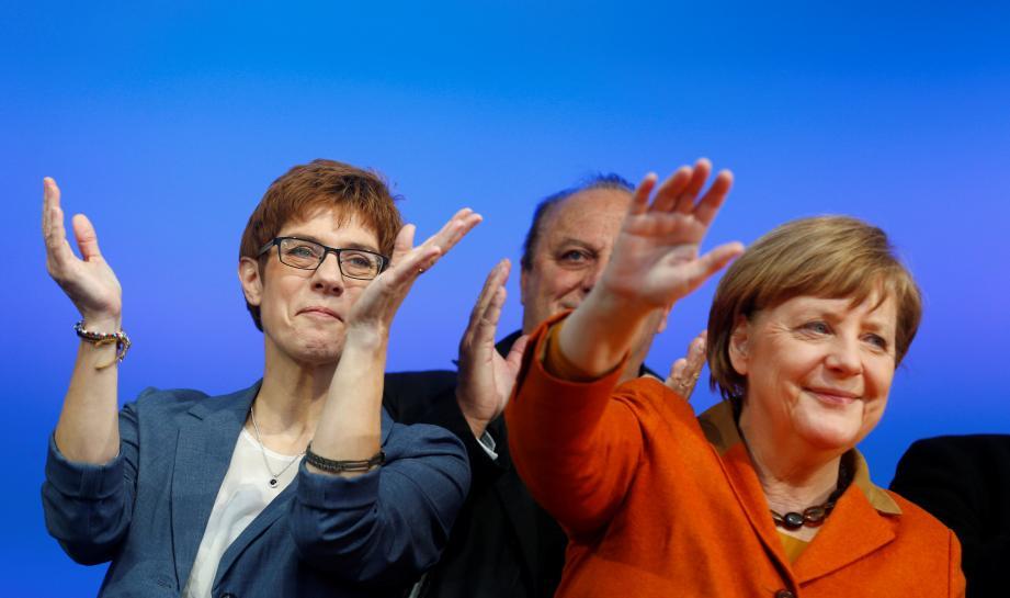 Germans in tiny Saarland vote in big test for Merkel
