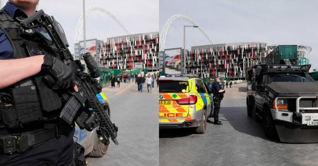 Armed police stand guard at Wembley to protect 90,000 fan descending on London