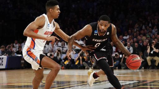 South Carolina upsets Florida to reach the NCAA tournament's Final Four for the first time in history. https://t.co/tOsy9oRzl1